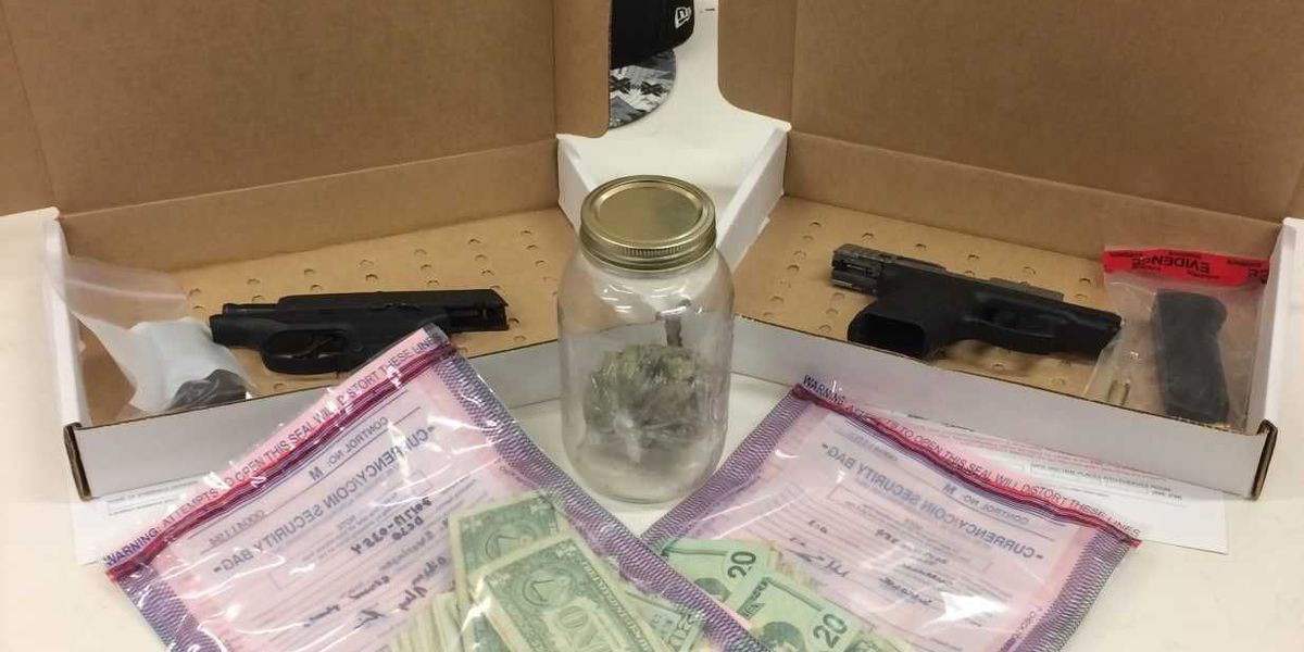 Over an ounce of marijuana, two firearms seized following traffic stop in Darlington County
