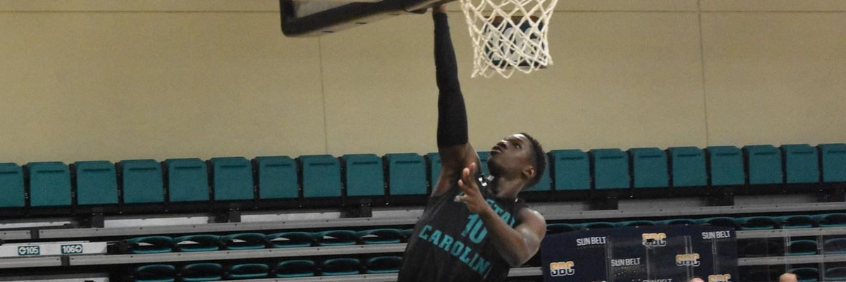 Dibba's key baskets lift Coastal to 70-65 win over Troy