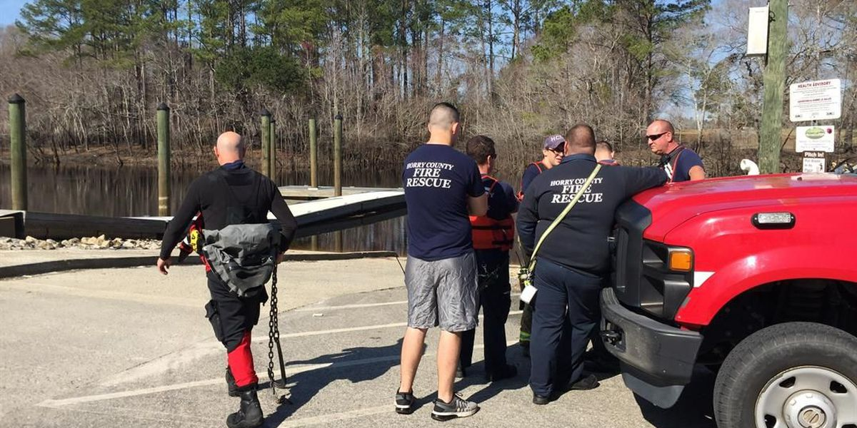 Safety personnel removing car from Waccamaw River