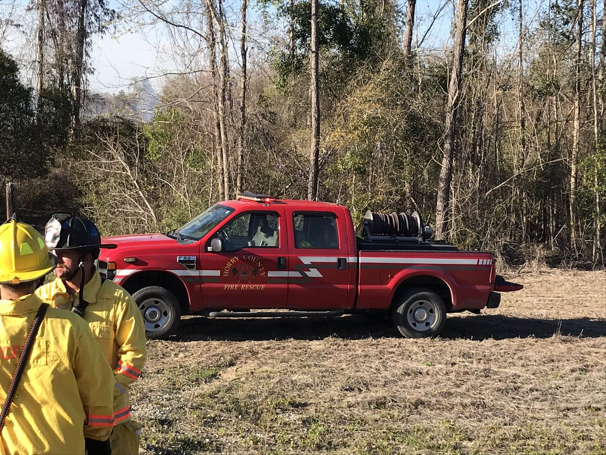 HCFR: Controlled burn cause of 25-acre brush fire near Pee Dee Hwy