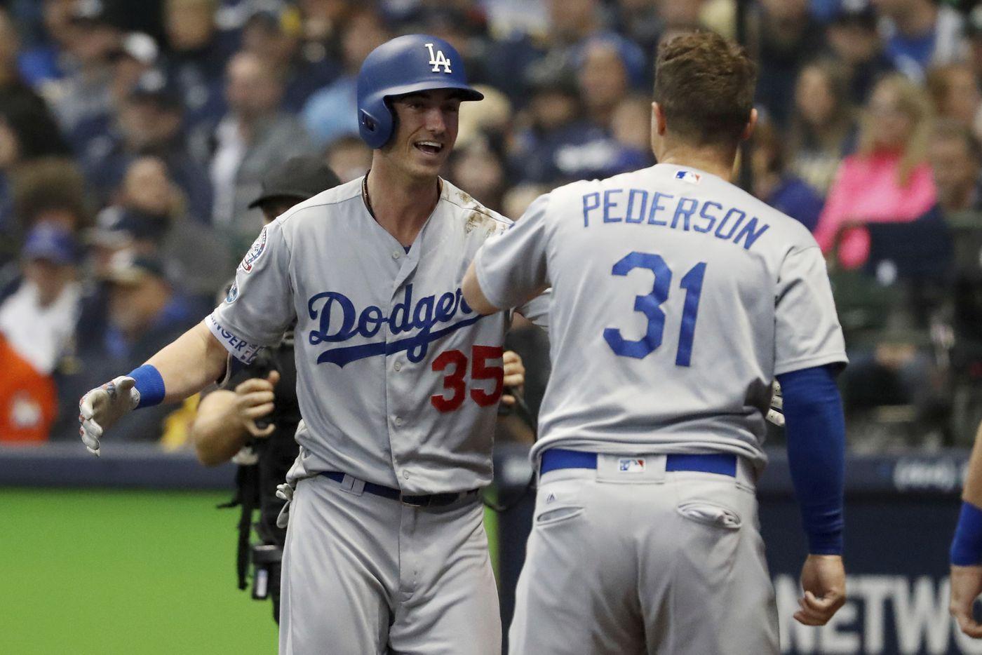 1034e72eabe98 Los Angeles Dodgers  Cody Bellinger (35) celebrates with Joc Pederson (31)