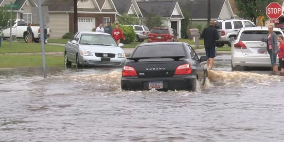 Cars stall on flooded roads in Palmetto Pointe