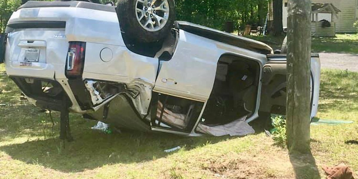 Officers help free two women trapped in SUV after crash
