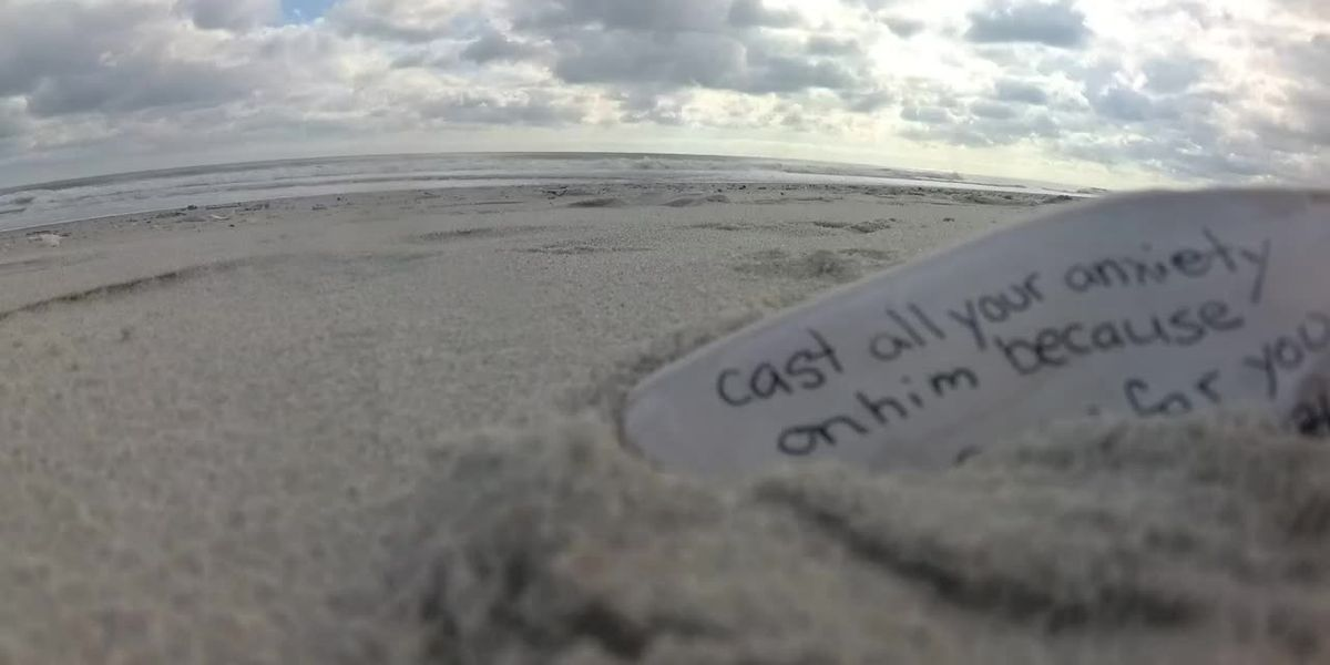 Woman leaves messages in seashells