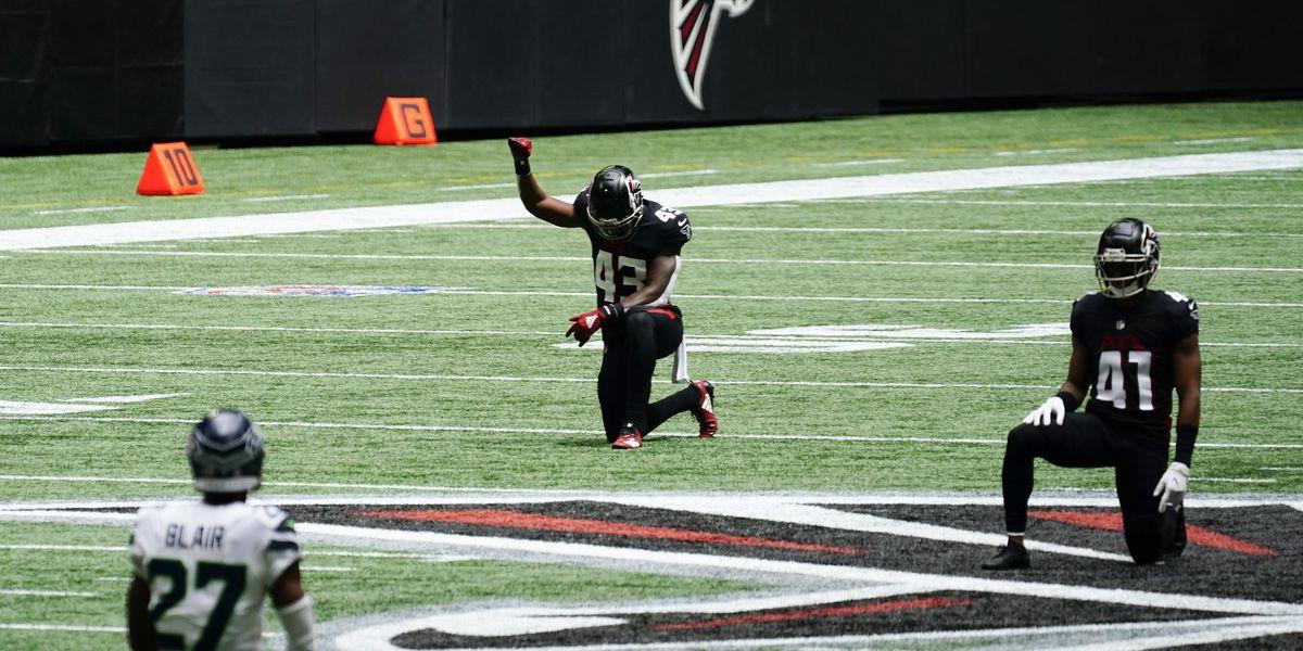 Falcons, Seahawks honor late U.S. Rep. John Lewis before game