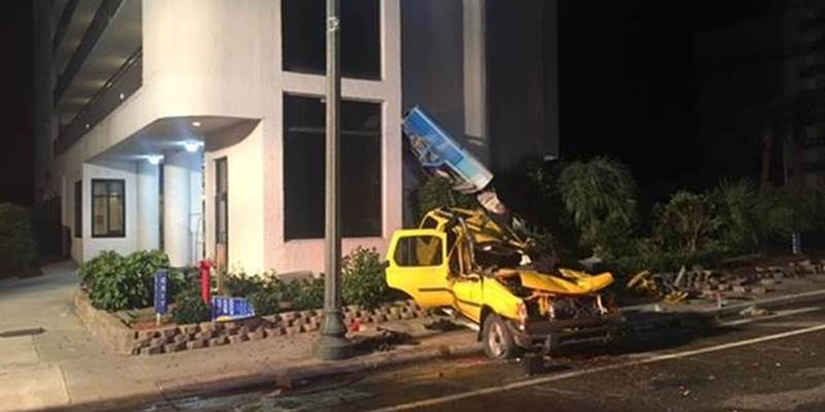 Vehicle stolen in Columbia crashes into Myrtle Beach hotel sign