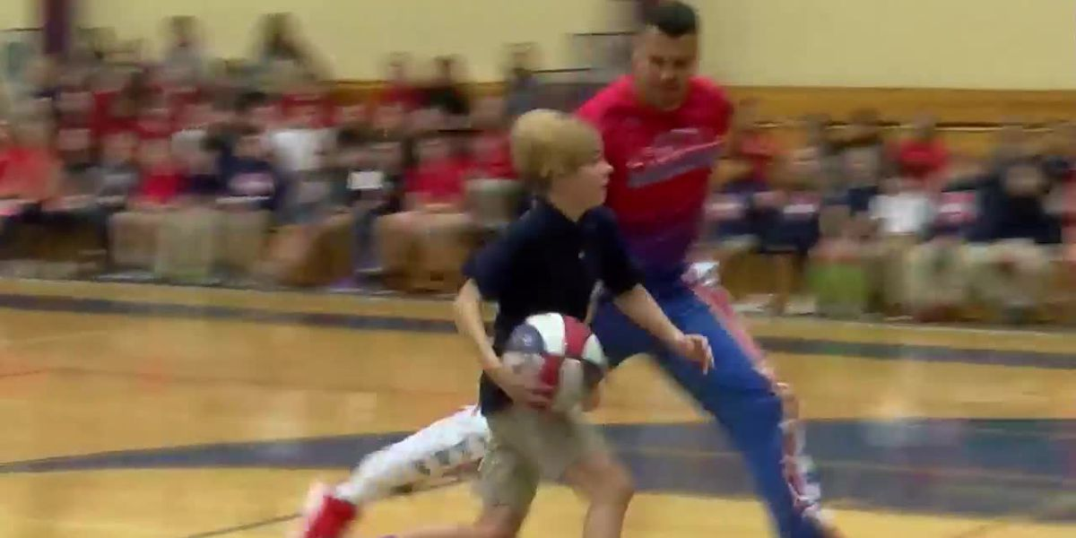 Student plays basketball with Harlem Globetrotters