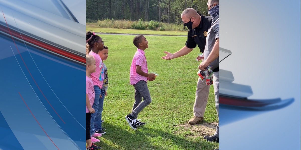 Deputies visit Camp Robeson, show off pink patrol cars for 'Cancer Awareness Pink Out Day'
