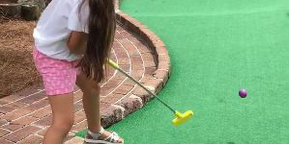 Little girl sinks an unbelievable hole in one