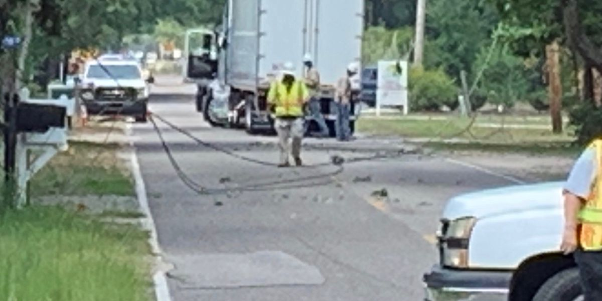 Semi-truck becomes entangled in power lines, causes outages in Murrells Inlet area, according to fire officials