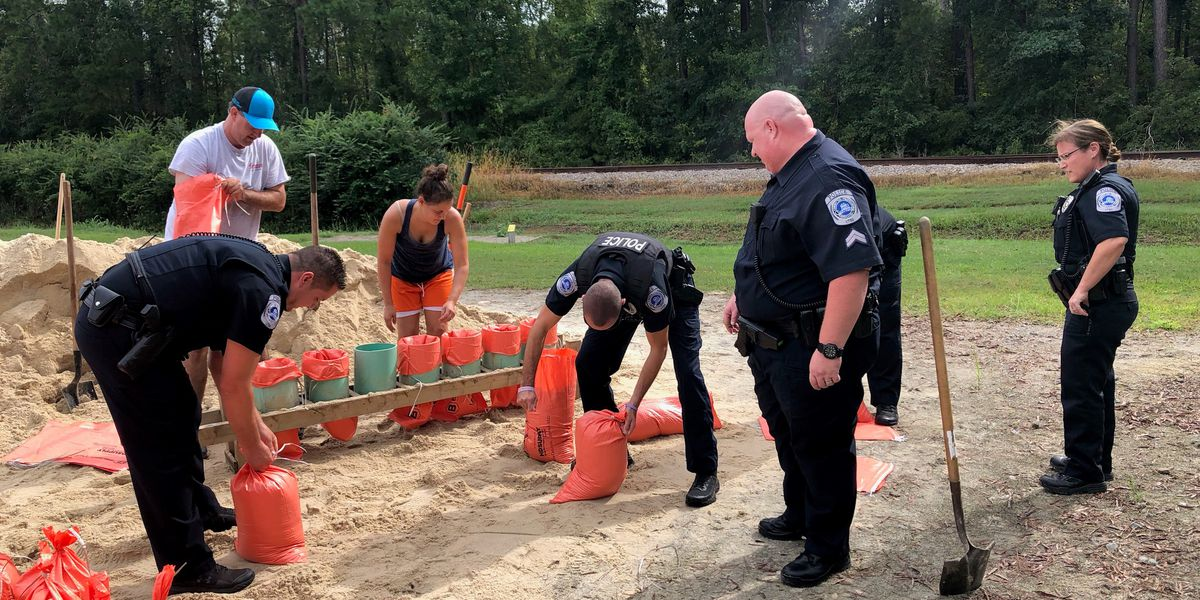 Conway police help residents bag during Dorian preparations