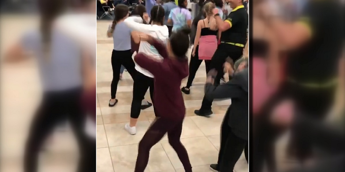 VIDEO: Spirit Airlines employee dances with cheer team delayed at MYR