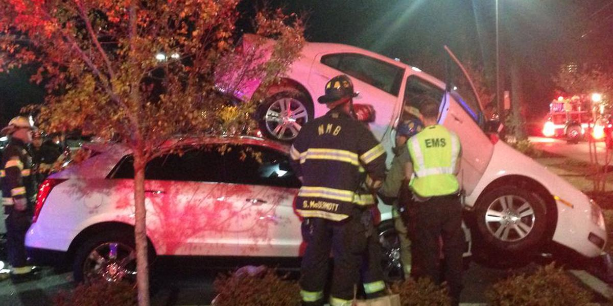Car ends up on top of two cars in a North Myrtle Beach parking lot