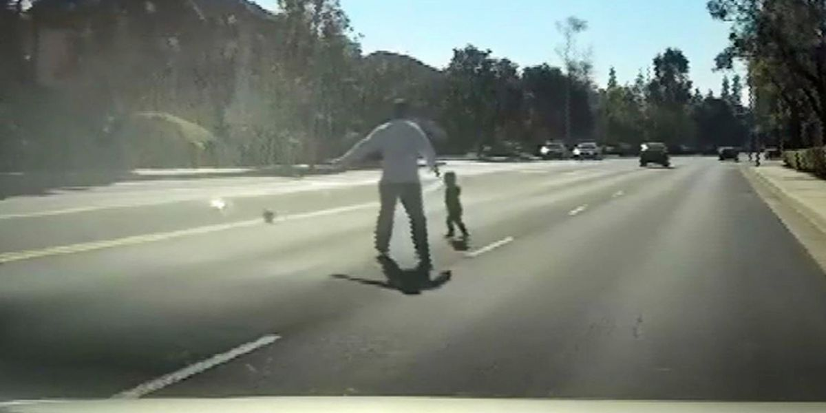 Toddler plays in traffic, gets rescued by former police officer