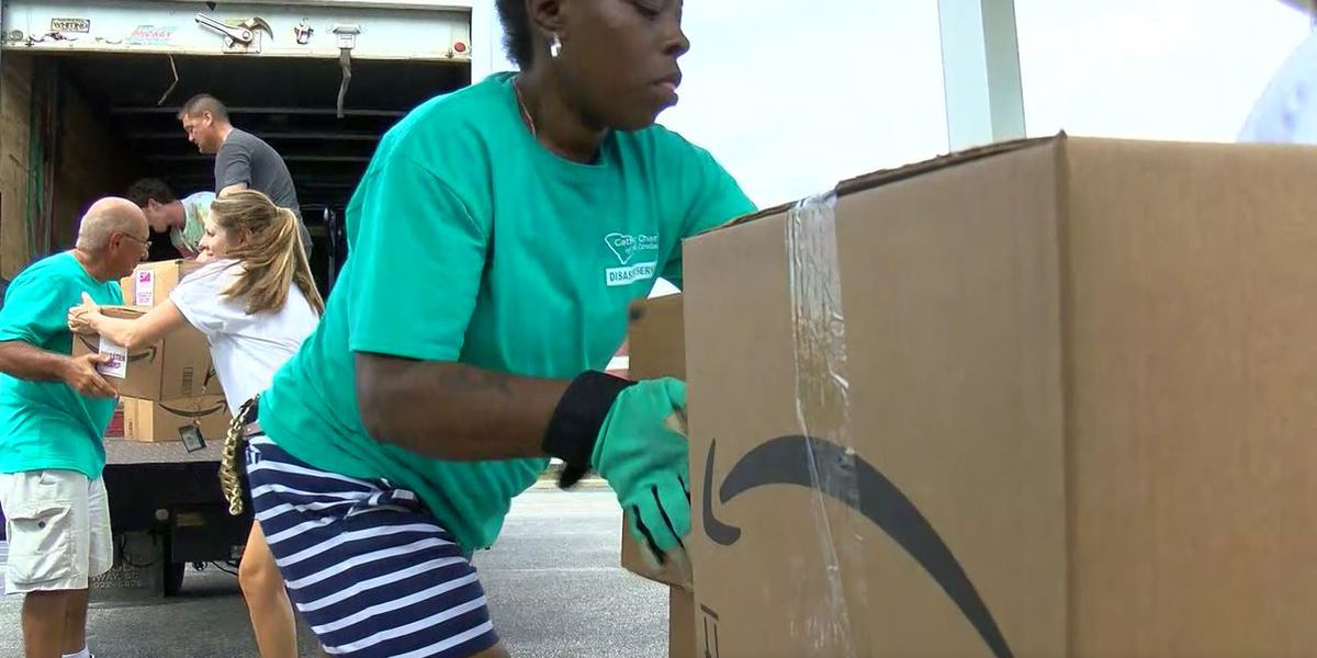 Volunteers and Neighbors lend helping hand to flood victims