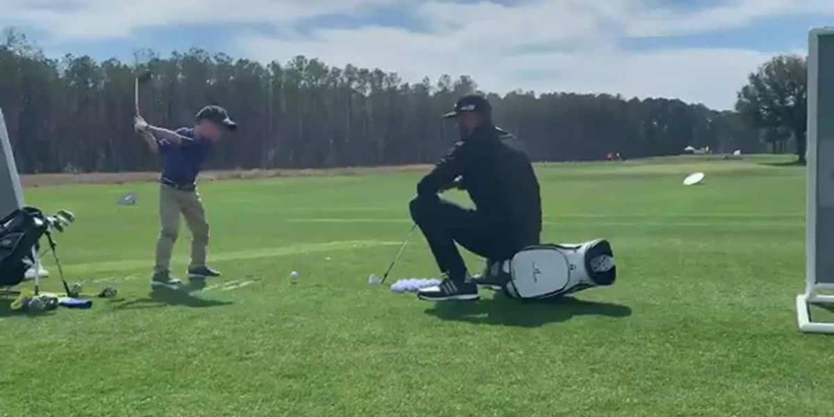 Dustin Johnson with young golfer