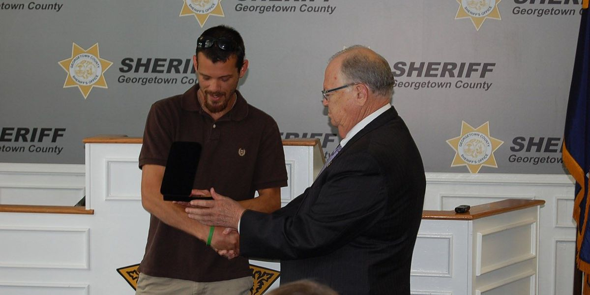 Sheriff honors Murrells Inlet man who rescued two women from sinking Jeep
