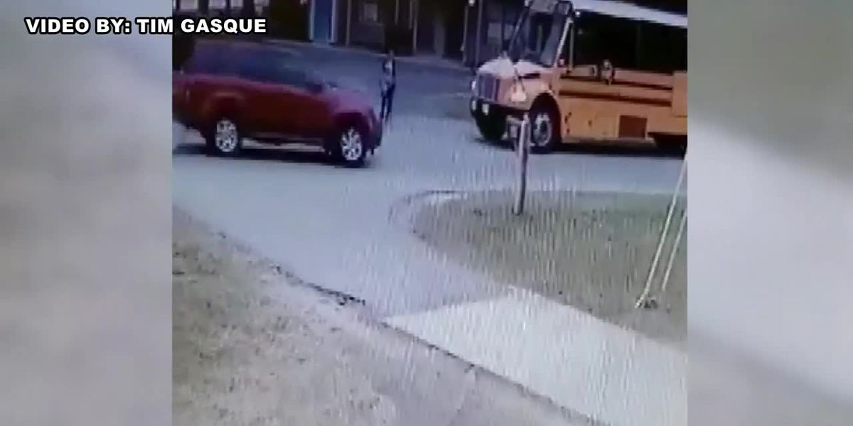 Boy almost hit while getting off school bus