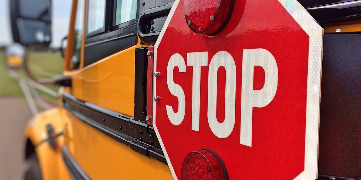 Crash involving school bus, truck sends 1 student to hospital