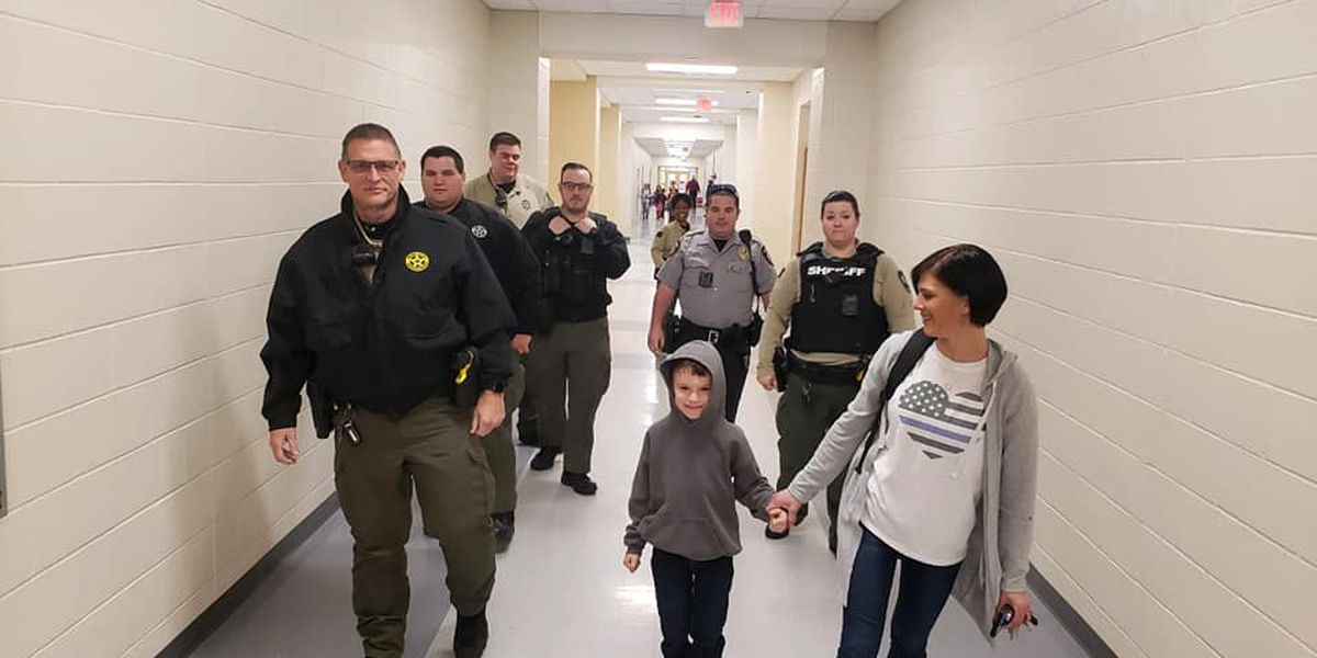 Deputies escort child into school after he was bullied by classmates