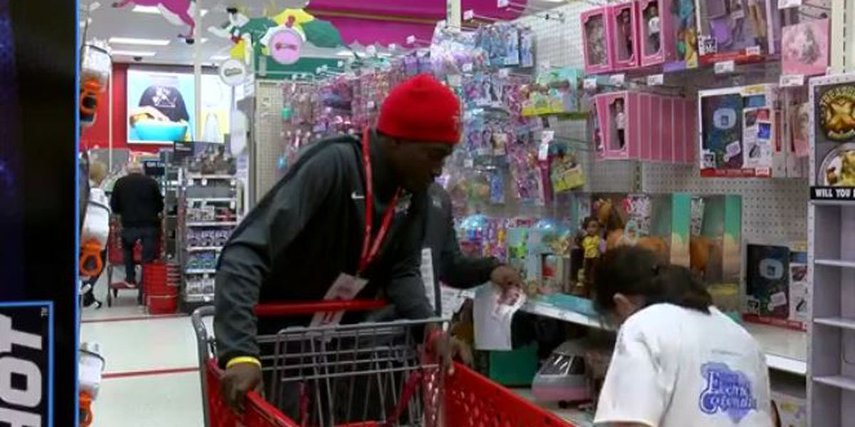 Football players from across the state help 44 Horry County school students go Christmas shopping