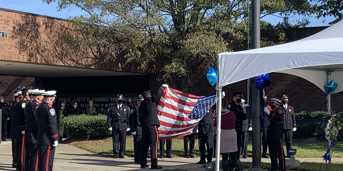 Myrtle Beach police lower, fold flags to present to fallen officer's family