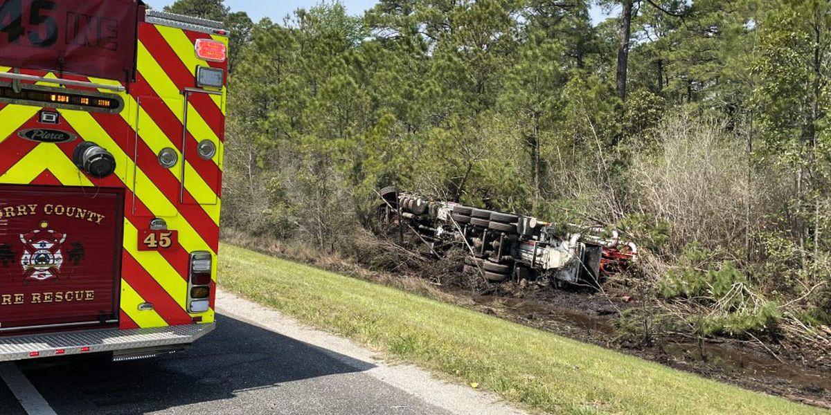 Concrete truck overturns on Highway 31