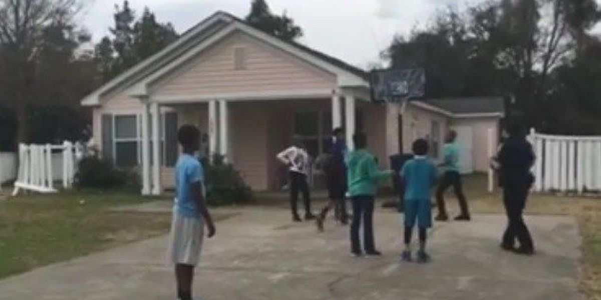 Myrtle Beach Police Officers play basketball with community kids