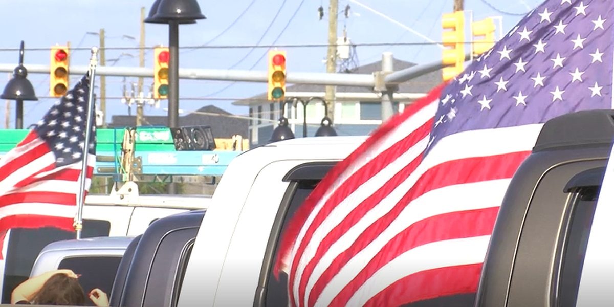 American flags being handed off, traveling from Wrightsville Beach to California